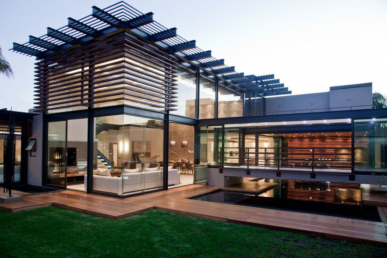 http://residencestyle.com/wp-content/uploads/2014/12/Contemporary-Home-Exterior-Design-Idea-with-Glass-Wall-and-Green-Grass.jpg