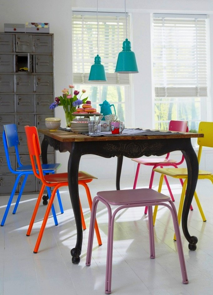 eclectic mix of dining chair colors and styles