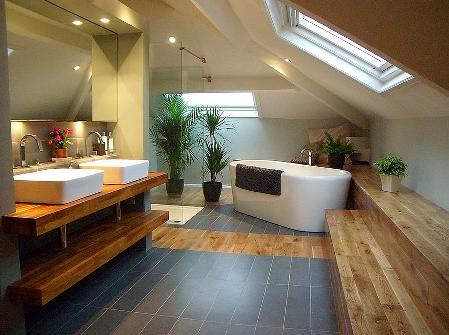 Dashing bathroom with slanted ceiling and skylight