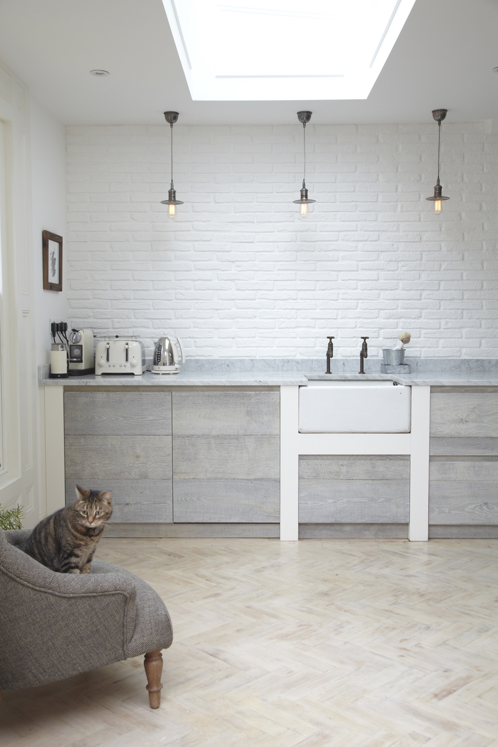 Herringbone Wood Floor white brick Scandinavian Kitchen