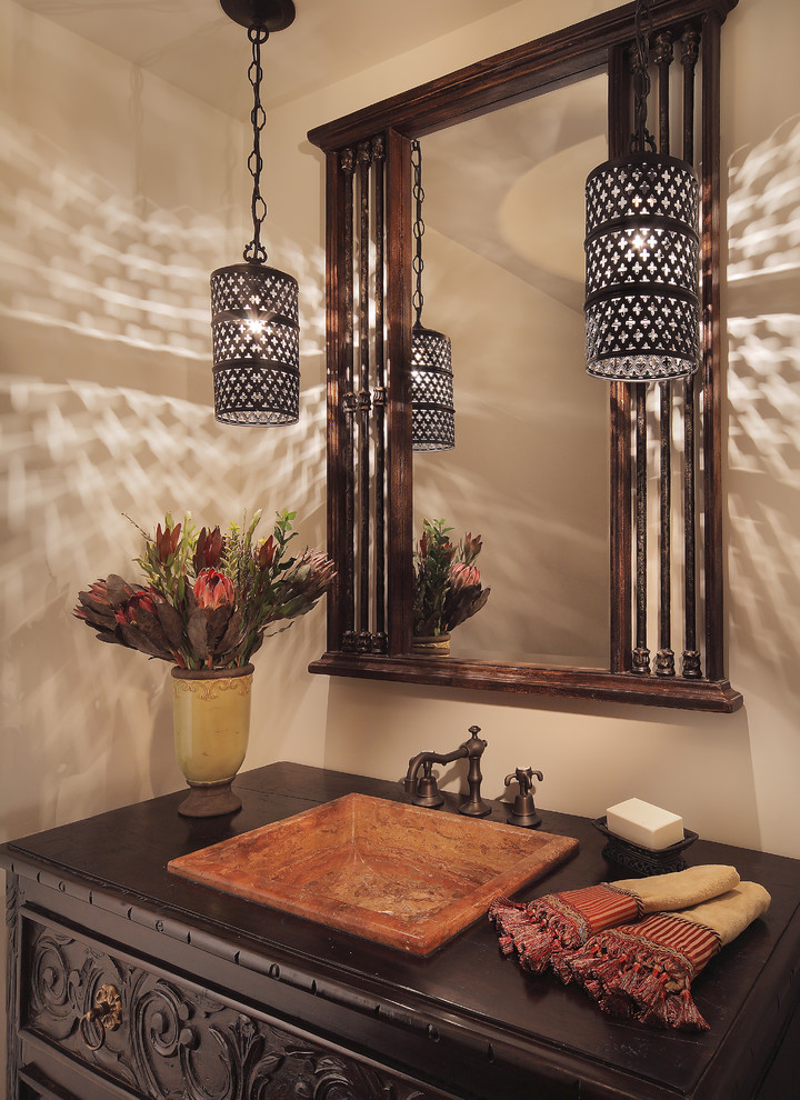 dark wood cabinets with lamp in bathroom
