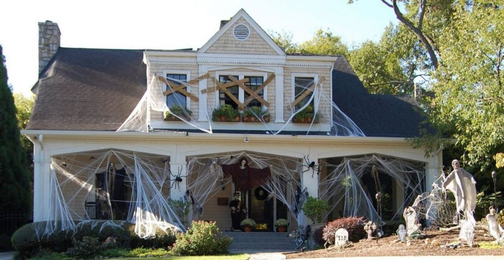 decorations incredible outdoor halloween spiderweb and flying ghosts haunted halloween house - Halloween Home Decor