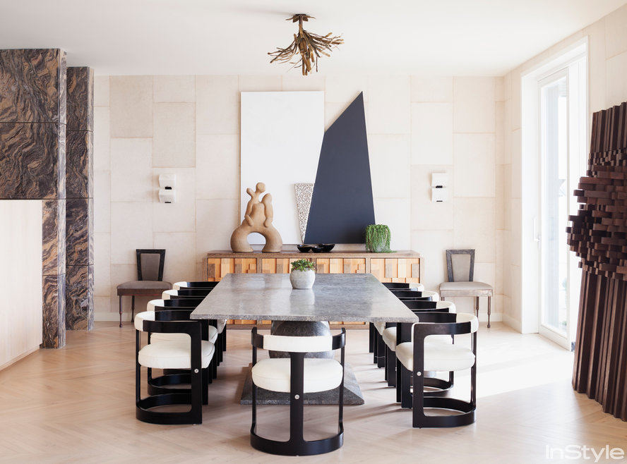 The sunken dining room stone table and modern chairs