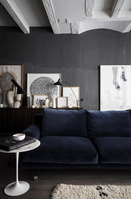 dark walls with blue sofa interior
