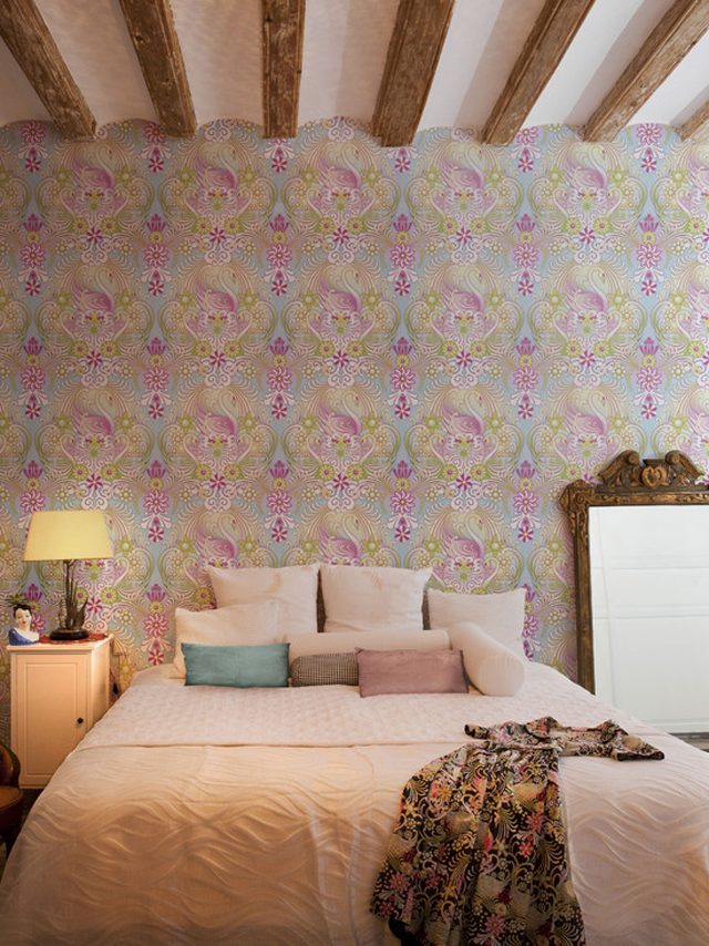 Bedroom with an artistic wallpaper design