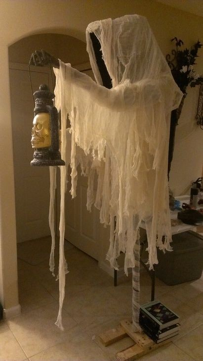 Cloaked Halloween ghost decorations with skull lantern