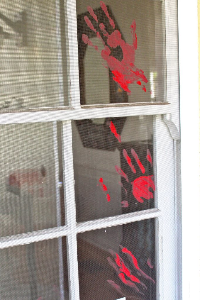 bloody handprint on window
