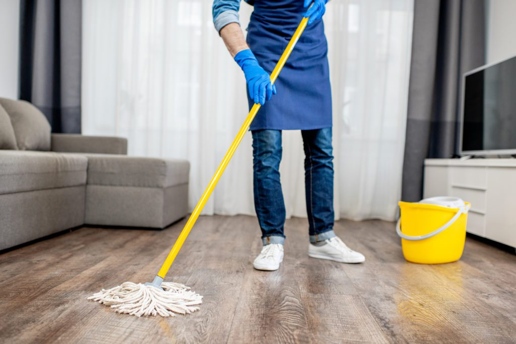 Man washing floor in the apartment